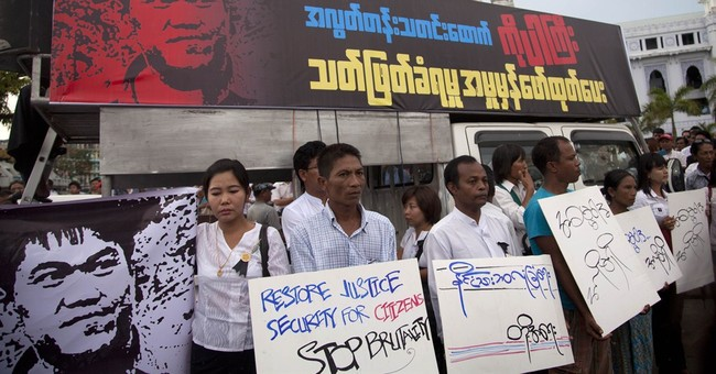 Wife: Signs of torture on body of Myanmar reporter