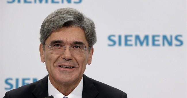 Siemens net profit up 40 percent, outlook cautious