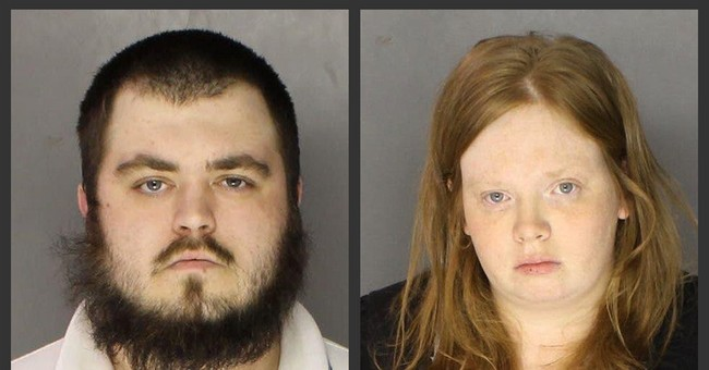2 charged in death of boy hung by feet, beaten