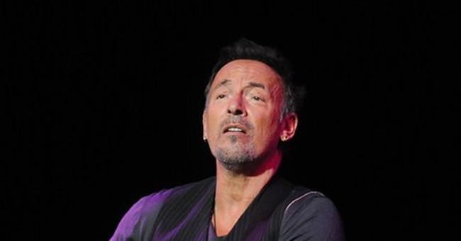 Springsteen auctions guitars, lasagna for veterans
