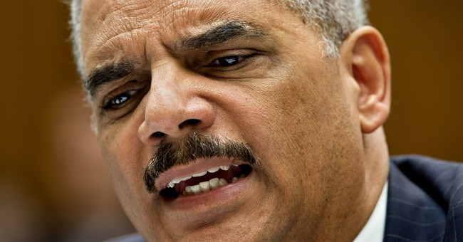 Holder aims vulgarity at critics in email
