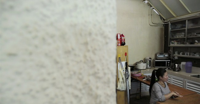 Hong Kong domestic workers struggle in risky jobs