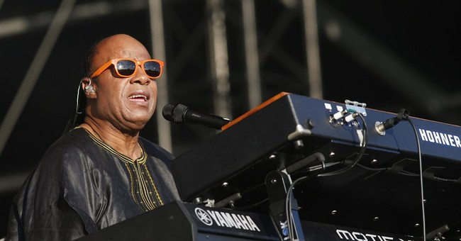 Wonder mixes politics with music in tour kickoff