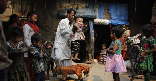 Image of Asia: Child's play in ragpickers colony