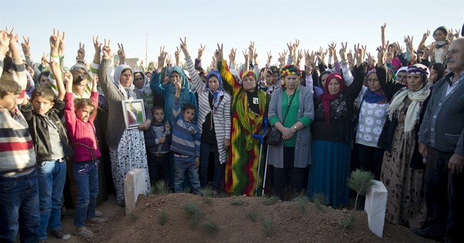 19-year-old fighter from Kobani buried in Turkey