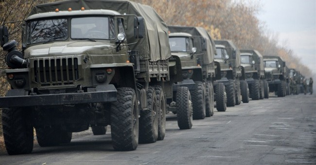 Ukraine rebels seen moving large military convoys