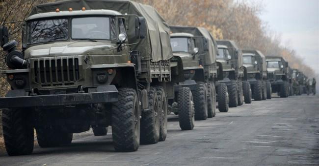 Ukraine rebels seen moving large military convoys