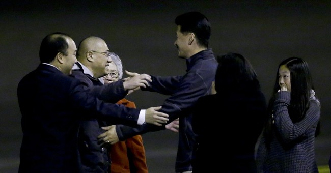 2 Americans held in North Korea whisked back home