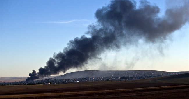 Syrian air raids kill at least 21 in IS-held town