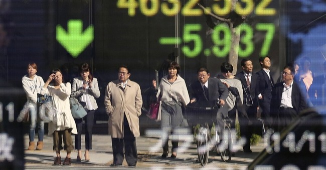 Asian stocks perked by record US close