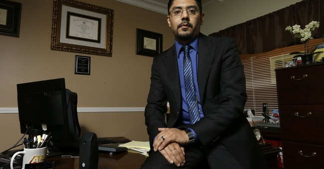 Immigrant lawyer hopes his effort inspires others