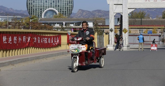 For blue skies at APEC, Chinese villages lose heat