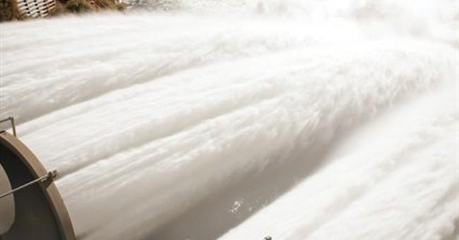 Feds flood Colorado River through Grand Canyon
