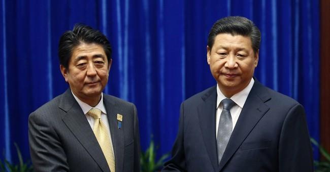 An awkward handshake: Leaders of China, Japan meet