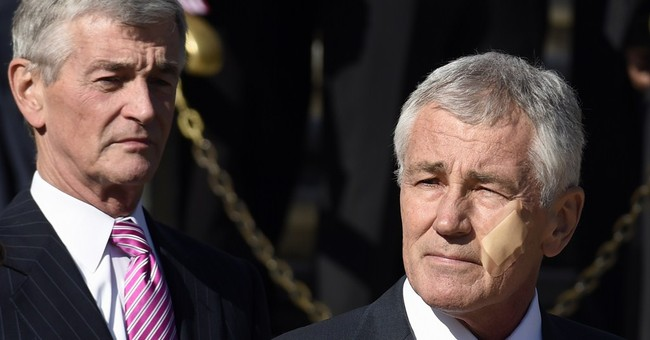 Hagel sports face bandage at Veterans Day ceremony