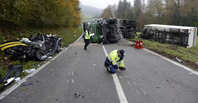 Crash involving Swiss postal bus kills 2