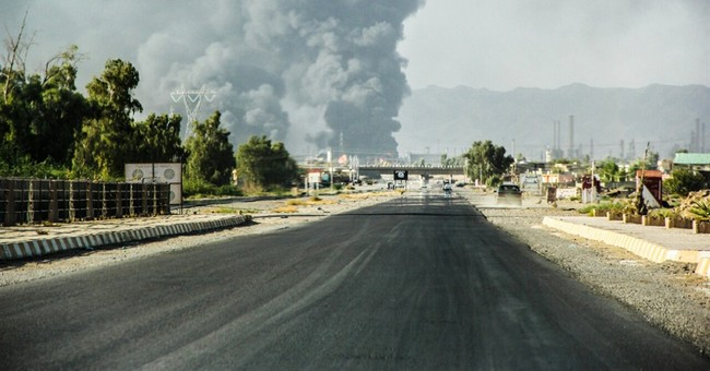 Iraqi forces retake most of strategic oil town