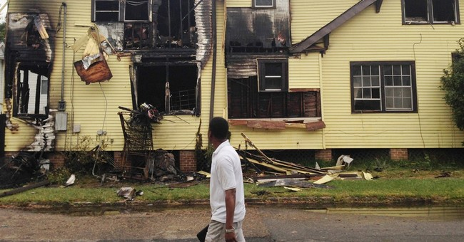 Tight-knit community mourns family's death in fire