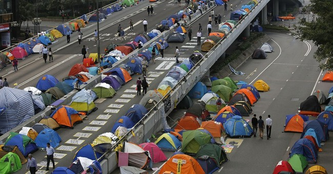 Hong Kong official warns protesters face arrest
