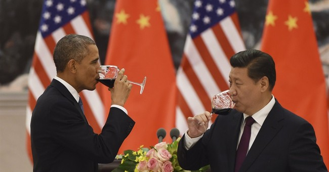 Obama, Xi seek to downplay persistent tensions