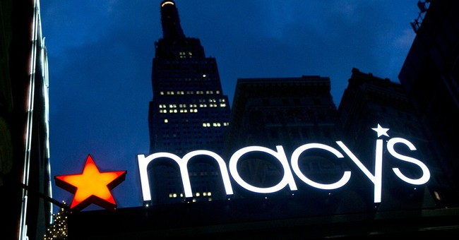 Macy's cuts outlook in sign of discounts to come