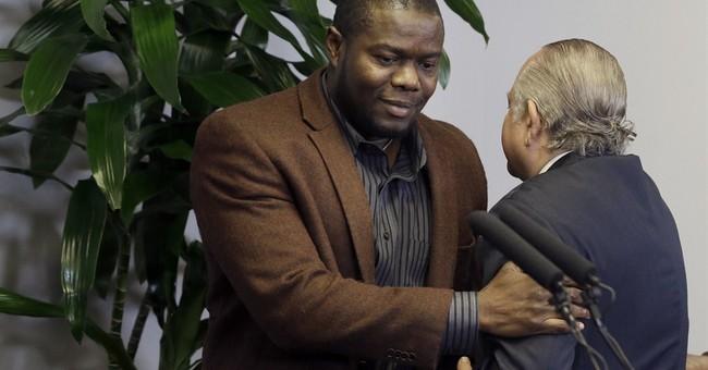Ebola victim's family, hospital reach settlement