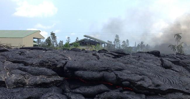 Lava burns asphalt at edge of Hawaii town