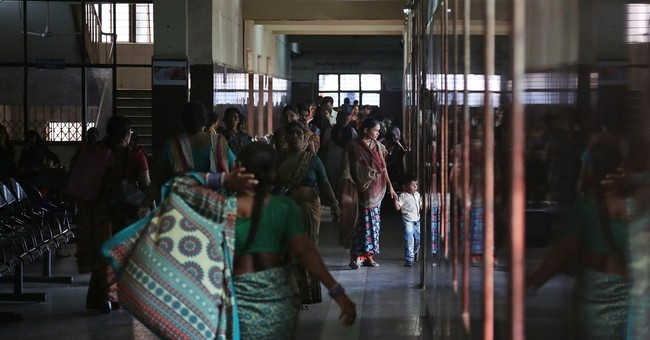 India doctor arrested, denies role in women deaths