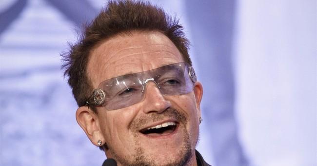 Bono's plane loses hatch before landing in Berlin
