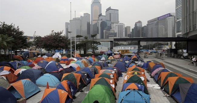 Hong Kong activists plan trip to Beijing Saturday