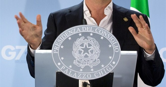 Italy's Renzi defies his own allies on Left