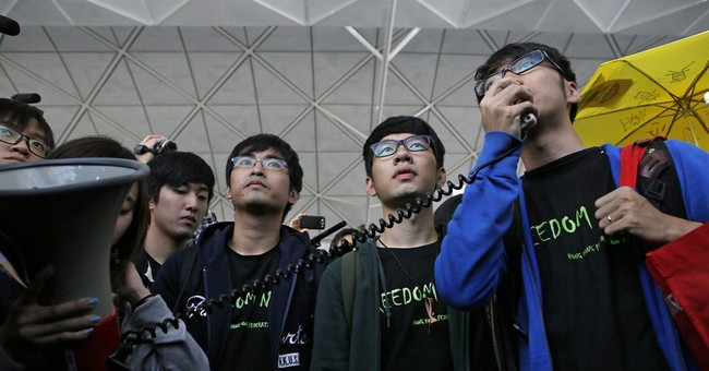 Hong Kong activists denied permit to go to Beijing