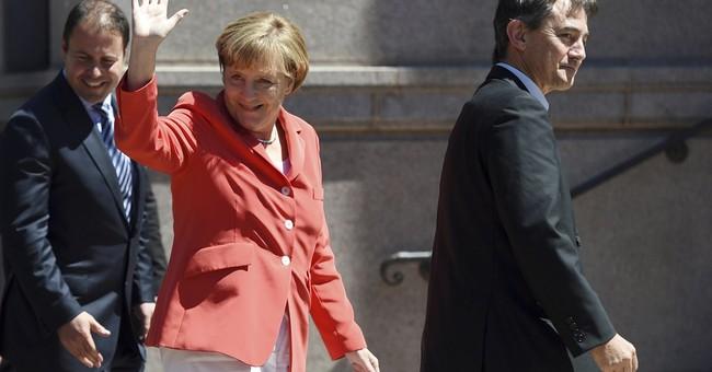 Tough stances from Putin, Merkel over Ukraine