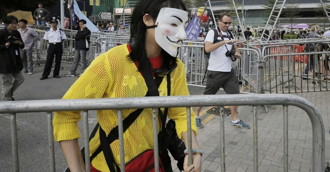 Some barricades cleared from HK protest site