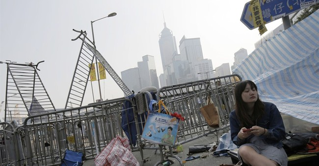 Removal of barricades begins at HK protest site