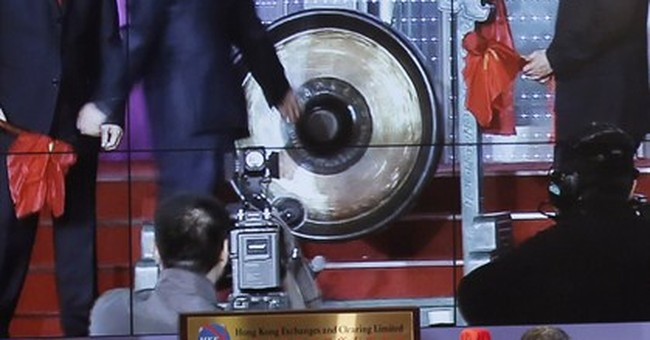 Hong Kong-Shanghai stock link makes lopsided debut