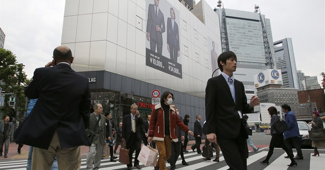 Japan slides into recession as tax hike takes toll