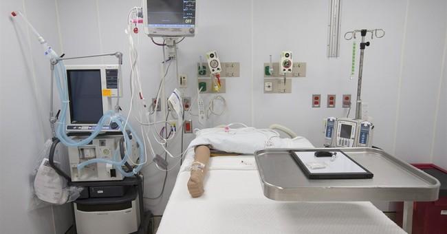 Hospitals improvise Ebola defenses, at a cost