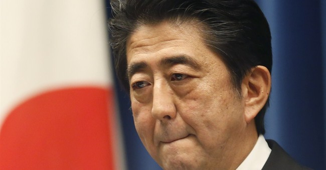 Japan's Abe calls snap election, puts off tax hike