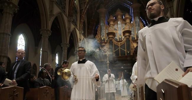 Cupich becomes Chicago archbishop, decries abuse