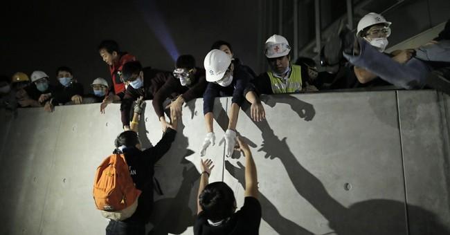 Hong Kong activists try to storm legislature
