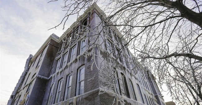 19th century school caked in ice after fire