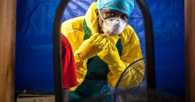 CDC chief drops worst-case Ebola estimate