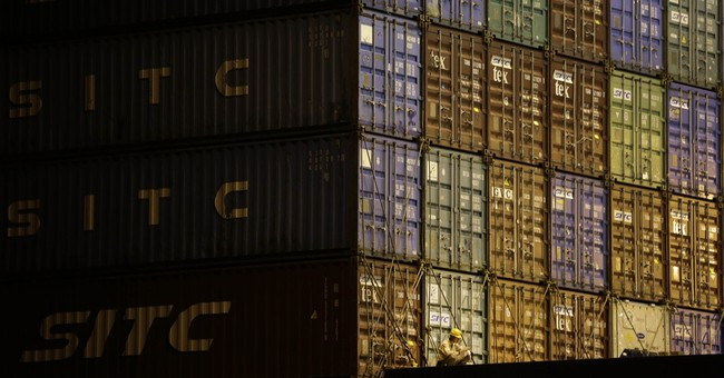 Japan trade deficit narrows in Oct as exports rise