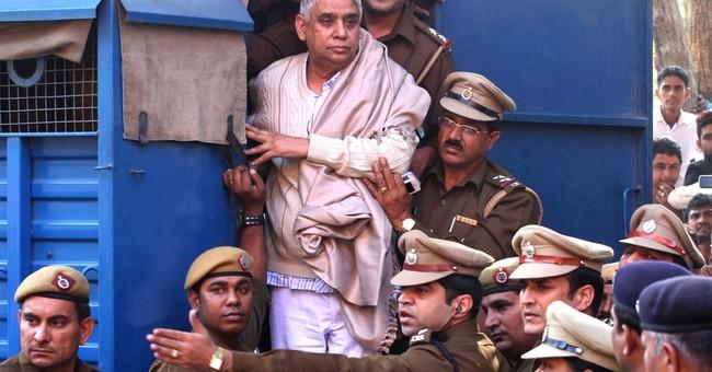 Police search Indian guru's ashram after arrest
