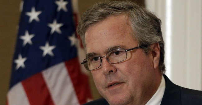 Bush seeks common ground with education critics