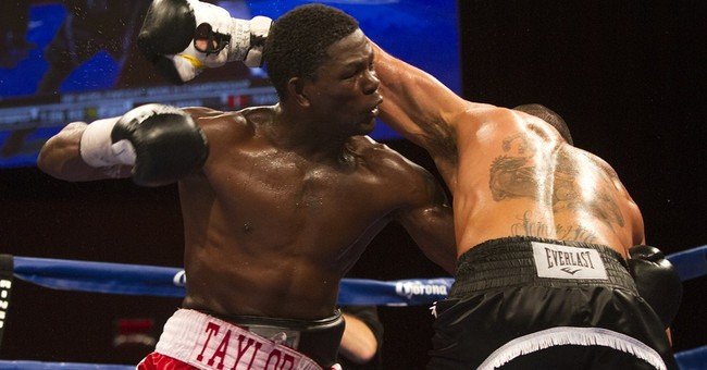 Boxer Jermain Taylor charged in Arkansas shooting