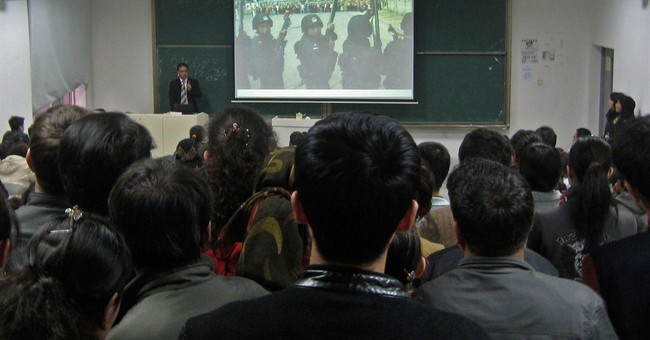 Chinese state media give profs a chilling warning