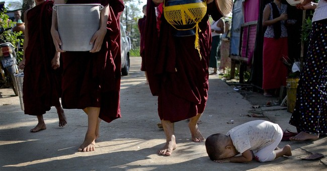 AP PHOTOS: 'Most generous' Myanmar's giving cycle