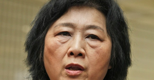 China party paper backs charges against journalist